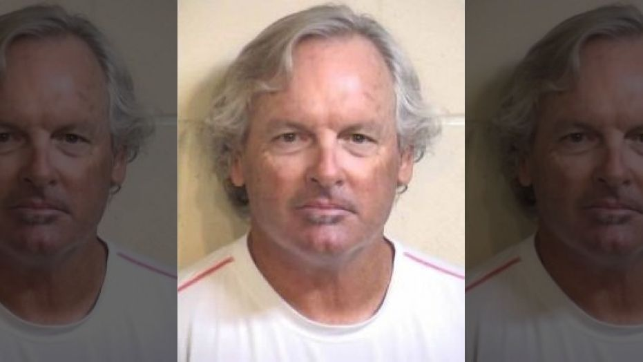 Peter Samhammer, 64, was arrested by police after he allegedly choked students with a jump rope as a form of