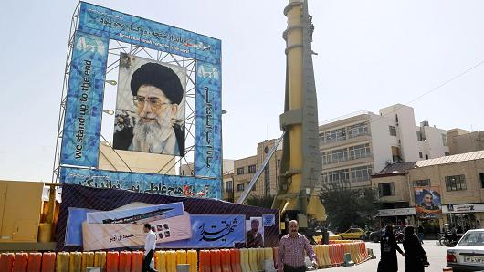 A missile is displayed next to a portrait of Iran's Supreme Leader Ayatollah Ali Khamenei at a war exhibition south of Tehran on September 26, 2016.