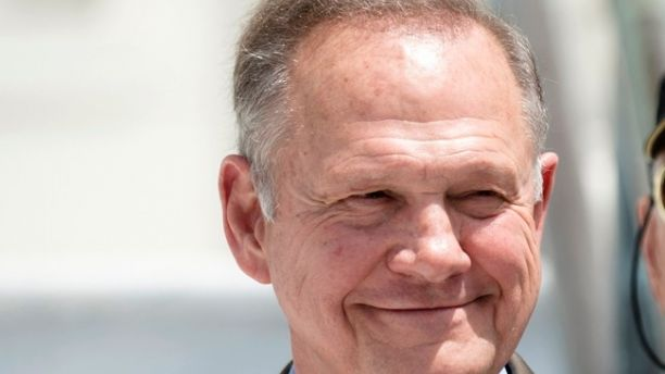 FILE -In this April 26, 2017 file photo, Roy Moore smiles before announcing his Alabama Junior Senate race candidacy, in Montgomery, Ala. As former Alabama Chief Justice Roy Moore, runs for U.S. Senate, he doesn't shrink from telling voters he has twice been ousted from the bench for defying federal courts over the Ten Commandments and same-sex marriage. Instead, he wears those rejections as a badge of honor. (Albert Cesare/The Montgomery Advertiser via AP, File)
