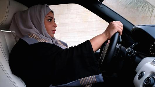 A Saudi woman drives her car along a street in the Saudi coastal city of Jeddah, on September 27, 2017.