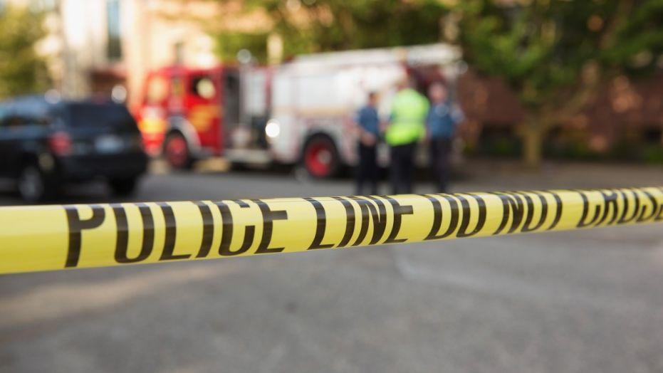 Police tape marks a crime scene, June 5, 2014.