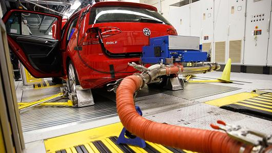 Hoses connect laboratory emission testing equipment to a red 2016 Volkswagen AG Golf TDI inside the California Air Resources Board Haagen-Smit Laboratory in El Monte, California.