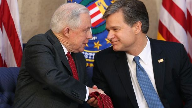 Attorney General Jeff Sessions shakes hands with Christopher Wray during a installation ceremony for Wray as the new FBI director at the FBI Building, Thursday, Sept. 28, 2017, in Washington. (AP Photo/Andrew Harnik)