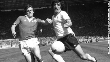Manchester United's Steve Coppell (left) attempts to tackle Liverpool's David Johnson during the 1977 FA Cup Final at Wembley Stadium.