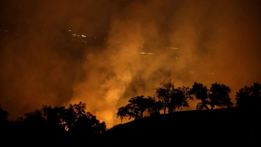 Will Carr reports on the extent of the devastation and the efforts of the firefighters.