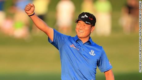 KJ Choi celebrates winning the 2011 Players Championship at TPC Sawgrass.