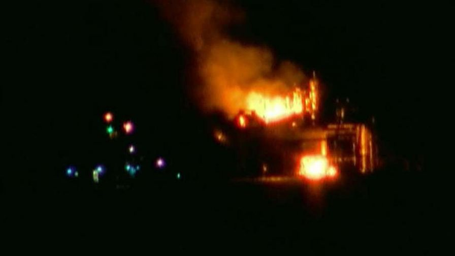 Coast Guard intensifies search for missing man after fiery blast.