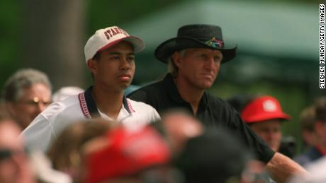Greg Norman and a young amateur Tiger Woods during a practice round at the 1995 Masters.