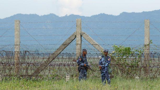 Myanmar border guard police force patrol near the Myanmar-Bangladeshi border outside Maungdaw, northern Rakhine state, Myanmar, November 12, 2017. Picture taken on November 12, 2017. REUTERS/Wa Lone - RC16C7540B10