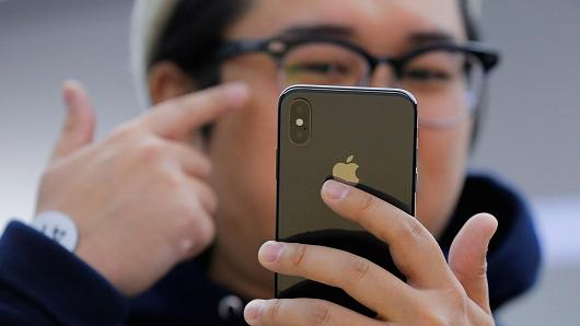 An attendee uses a new iPhone X during a presentation for the media in Beijing, China October 31, 2017.