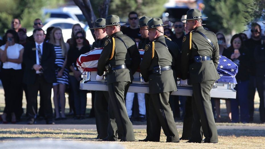 Border Patrol agents carry the coffin of Rogelio Martinez to a graveside service at Restlawn Cemetery in El Paso Saturday