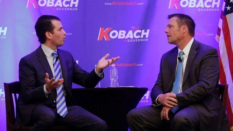 Donald Trump Jr., left, and Kansas gubernatorial candidate Kris Kobach talk during a fundraiser for Kobach's campaign, Nov. 28, 2017.