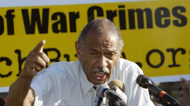 U.S. Representative John Conyers (D-MI) speaks at an anti-war rally near the White House in Washington, DC June 16, 2005, after delivering a petition to The White House signed by over 500,000 Americans and 94 members of U.S. Congress asking U.S. President George W. Bush to respond to questions raised by the