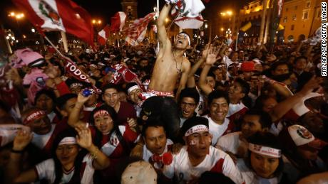 Supporters of Peru celebrate as their team beat New Zealand in the playoffs