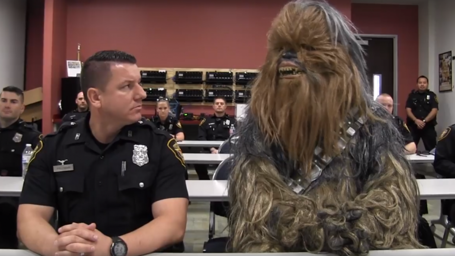 In a framegrab from the video starring Jimmy and Chewbacca, the pair show what a typical day on the force looks like.