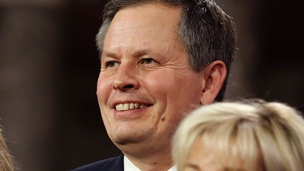 U.S. Senator Steve Daines (R-MT) smiles after he was ceremonially sworn-in by Vice President Joseph Biden in the Old Senate Chamber on Capitol Hill in Washington January 6, 2015.     REUTERS/Larry Downing   (UNITED STATES - Tags: POLITICS HEADSHOT) - GM1EB170DHP01