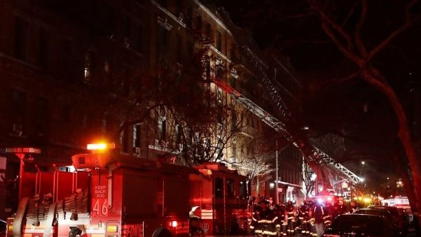 Firefighters respond to a building fire Thursday, Dec. 28, 2017, in the Bronx borough of New York. The Fire Department of New York says a blaze raging in a Bronx apartment building has seriously injured more than a dozen of people. (AP Photo/Frank Franklin II)