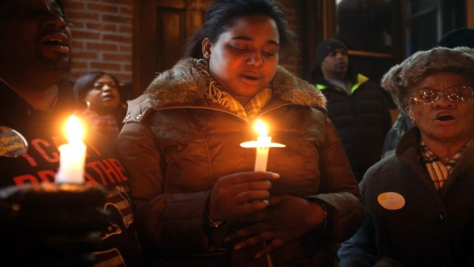 Eric Garner's daughter Erica Garner takes part in candlelight vigil at the site where her father died in July last year after being put in a chokehold, during a Martin Luther King Day service in the Staten Island borough of New York January 19, 2015.