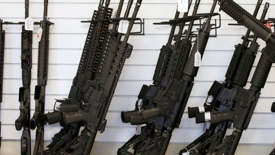FILE: Guns seen at a store in Provo, Utah. Federal authorities requested thousands of gun retrievals in 2016.