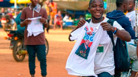 Supporters of candidate, ex-footballer George Weah react after they were given t-shirts at his Coalition for Democratic Change (CDC) party headquarters in Monrovia ahead of the run-off election.