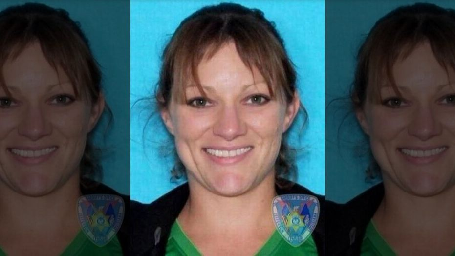Authorities considered Kelly Folse a suspect in the dog's death because of hostile text messages she reportedly sent his owner, WDSU said.