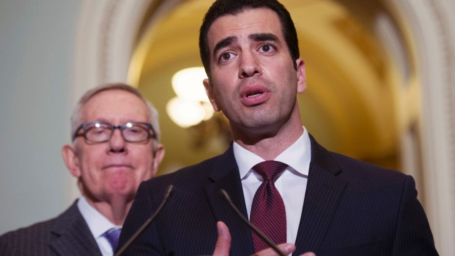 Rep. Ruben Kihuan, D-Nev., pictured last year with then-Sen. Harry Reid, D-Nev., was elected to Congress in 2016.