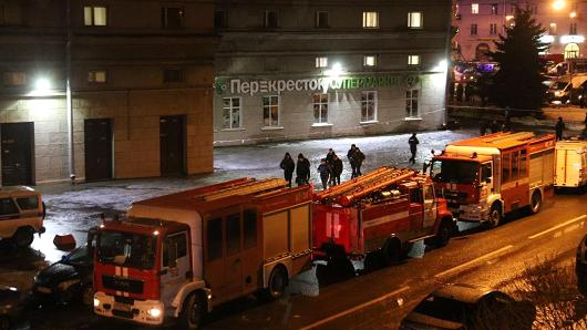 Security forces are seen outside the supermarket in Kalinina Square after an explosion in St. Petersburg, Russia on December 27, 2017. A total of nine people were injured after an explosion hit a store in St. Petersburg, Russia.