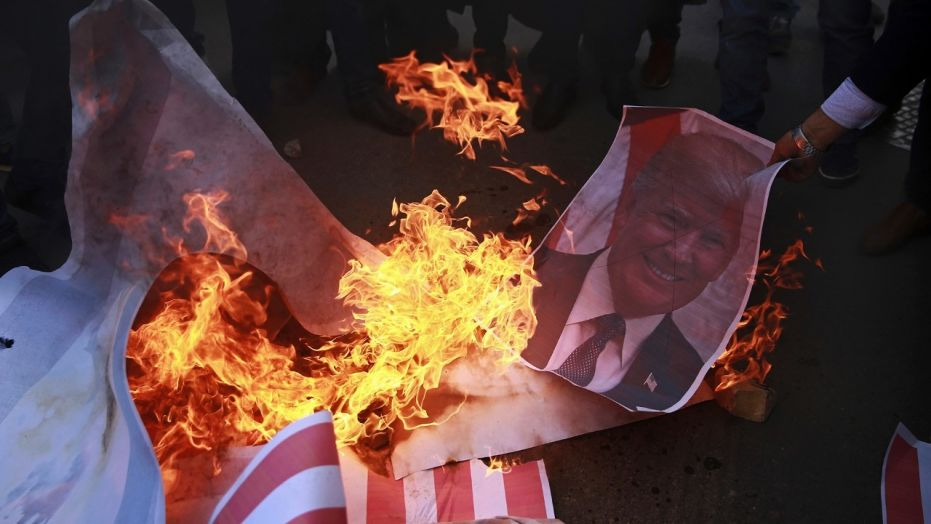 Palestinian Protesters Burn A Poster Of Presidenttrump And Representation An American Flag Earlier In