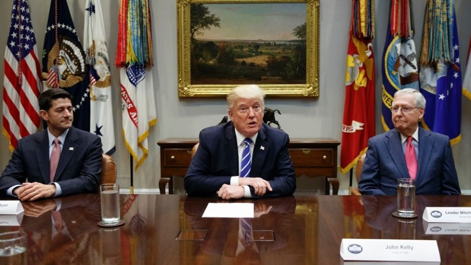 September 5, 2017: House Speaker Paul Ryan, R-Wis., left, and Senate Majority Leader Mitch McConnell, R-Ky., right, listen as President Donald Trump speaks during a meeting with Congressional leaders and administration officials on tax reform, in the Roosevelt Room of the White House in Washington.