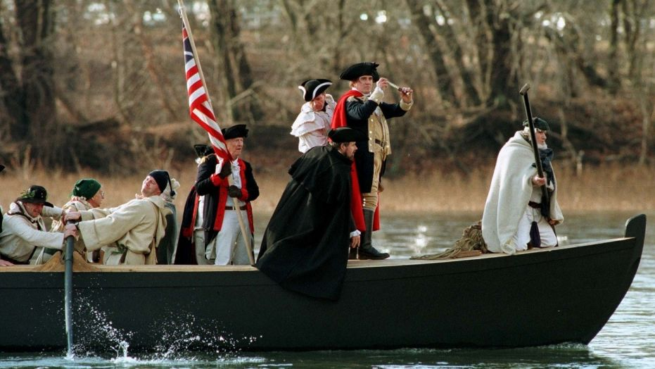 Gen. George Washington, portrayed by Bob Gerenser, of New Hope, Pa., crosses the Delaware River during a past re-enactment of a key turning point of the American Revolution.