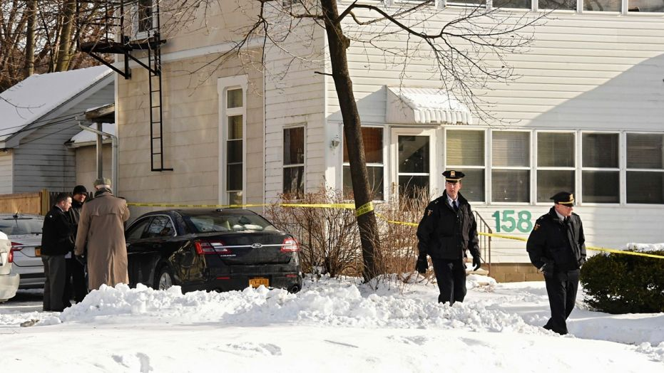 Police investigate the scene on on Tuesday, Dec. 26, 2017, in Troy, N.Y. after they say four people have been found dead and may have been killed in an apartment.