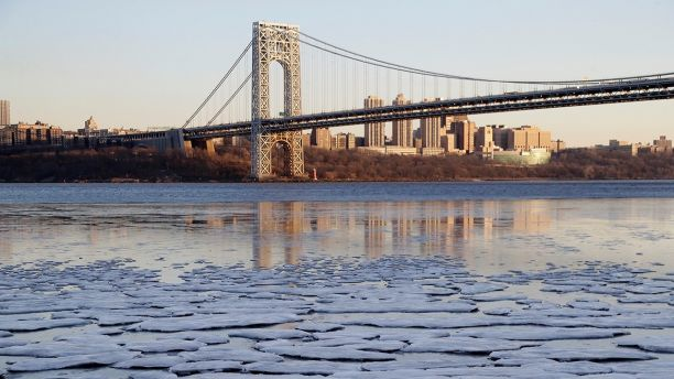 Small patches of ice formed along the banks of the Hudson River near the George Washington Bridge in Fort Lee, N.J., Tuesday, Jan. 2, 2018. Dangerously cold temperatures blamed for at least nine deaths have wreaked havoc across a wide swath of the U.S., freezing a water tower in Iowa, halting ferry service in New York and leading officials to open warming centers even in the Deep South. (AP Photo/Seth Wenig)