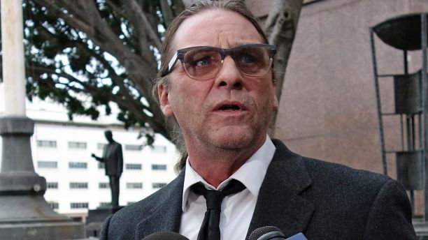 FILE - In this Jan. 8, 2018, file photo, Michael Channels speaks to reporters after a hearing in Los Angeles Superior Court. A Los Angeles judge on Friday, Jan. 26, 2018, will hear arguments on what county should decide who gets the remains of Charles Manson who orchestrated the 1969 killings of pregnant actress Sharon Tate and eight others. At least three parties, including Channels, have staked claims to collect Manson's body from the Kern County morgue two months after he died and take control of any assets, which could include potentially lucrative rights to the use of his image and songs he wrote and any other property. (AP Photo/Brian Melley, File)