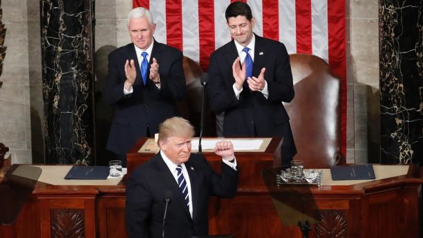 President Donald Trump, flanked by Vice President Mike Pence and House Speaker Paul Ryan of Wis., gestures on Capitol Hill in Washington, Tuesday, Feb. 28, 2017, before his address to a joint session of Congress. (AP Photo/Pablo Martinez Monsivais)
