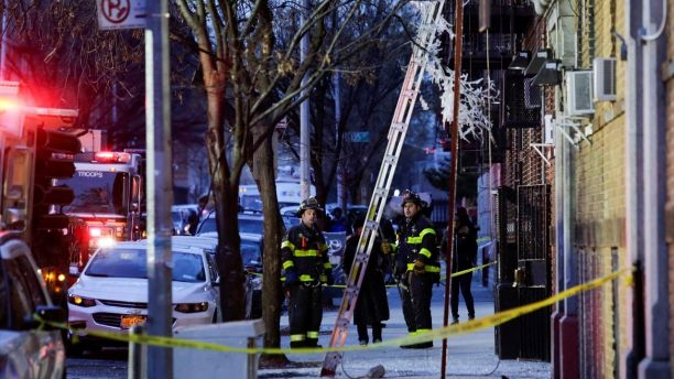 Fire Department of New York (FDNY) personnel work on the scene of an apartment fire in Bronx, New York, U.S., December 29, 2017. REUTERS/Eduardo Munoz - RC1C9028CE90