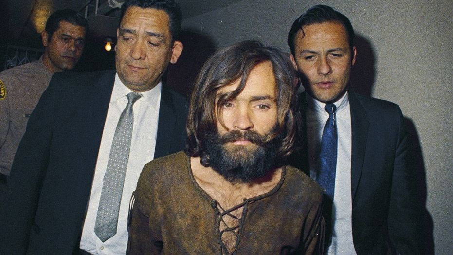 FILE - In this 1969 file photo, Charles Manson is escorted to his arraignment on conspiracy-murder charges in connection with the Sharon Tate murder case.