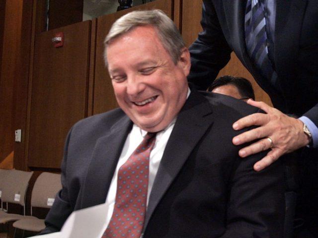 Dick Durbin laughs (Chip Somodevilla / Getty)