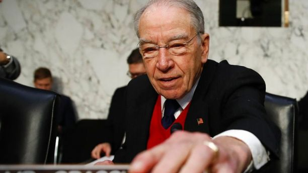 Senate Judiciary Committee Chairman Chuck Grassley, R-Iowa, arrives for a Senate Judiciary Committee hearing on Capitol Hill in Washington, Wednesday, Dec. 6, 2017, entitled: