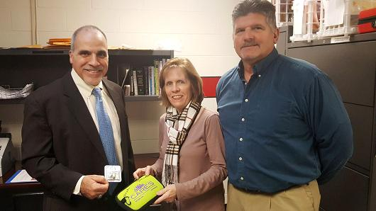 From left to right: Joseph Occhino, the principal of Northern Highlands Regional High School in Allendale, New Jersey, with school nurse Anne Rutkowski and supervisor of health and wellness Steve Simonetti. All have been trained to administer the lifesaving drug Narcan in case of an overdose on school grounds.