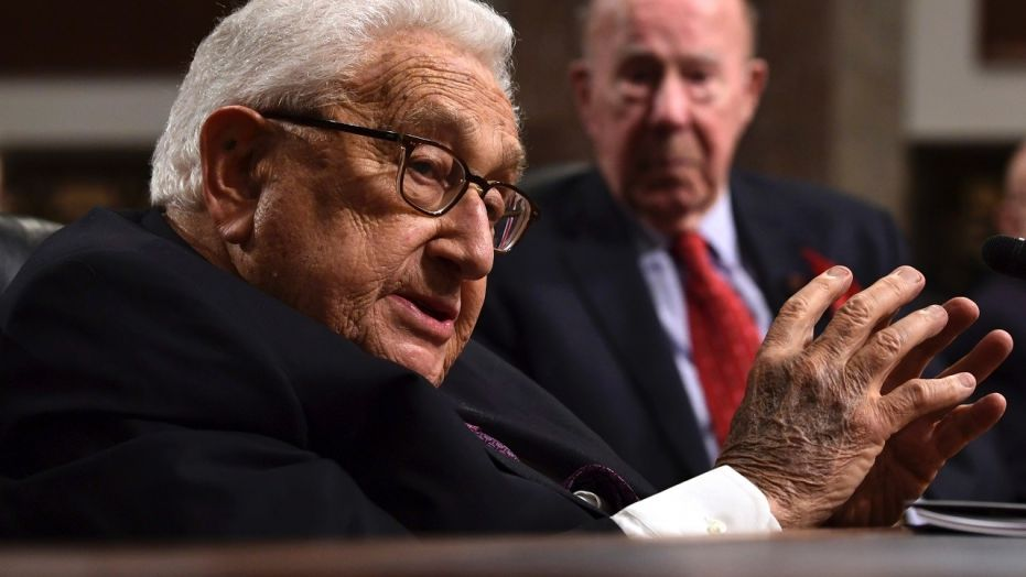 Former U.S. Secretary of State Henry Kissinger, 94, addresses the Senate Armed Services Committee, Jan. 25, 2018, with former U.S. Secretary of State George Shultz, 97, in the background.