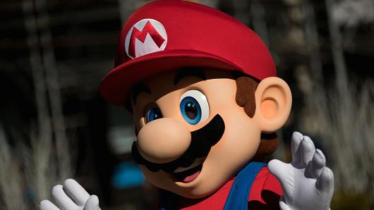 A person dressed as the Nintendo character Mario waves at a pop-up Nintendo venue in Madison Square Park, March 3, 2017 in New York City.