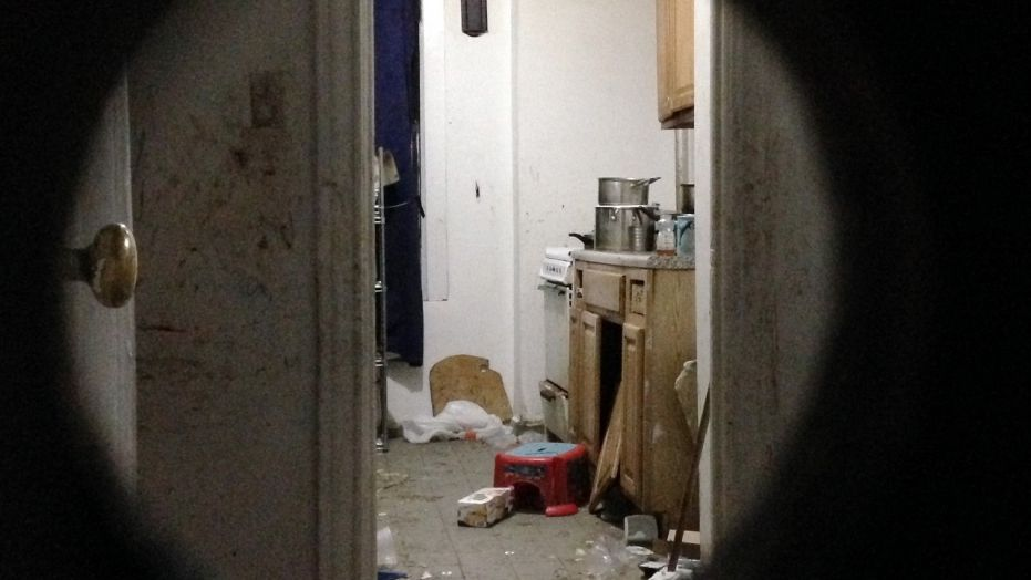 The dirty apartment where a 5-year-old boy was found Friday by a FedEx employee.