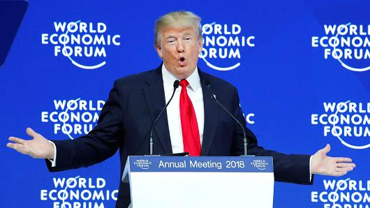 President Donald Trump gestures as he delivers a speech during the World Economic Forum (WEF) annual meeting in Davos, Switzerland January 26, 2018.