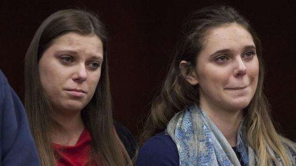Madison Rae Margraves, right, reacts while giving a statement near her sister, Lauren Margraves, during Larry Nassar's sentencing at Eaton County Circuit Court in Charlotte, Mich., on Friday, Feb. 2, 2018. Randall Margraves, father of Madison and Laurn, lunged at Nassar before court officers restrained him.  The incident came during the third and final sentencing hearing for Nassar on sexual abuse charges. The charges in this case focus on his work with Twistars, an elite Michigan gymnastics club.   (Cory Morse/The Grand Rapids Press via AP)
