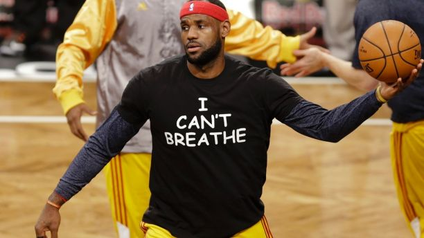FILE - In this Dec. 8, 2014 file photo, Cleveland Cavaliers' LeBron James wears a T-shirt reading