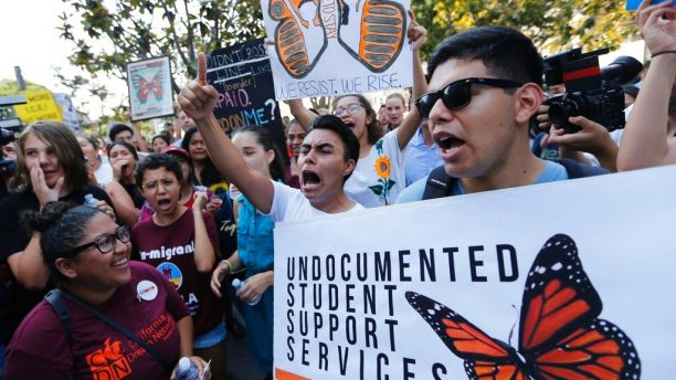 Undocumented students join a rally in support of the Deferred Action for Childhood Arrivals, or DACA program outside the Edward Roybal Federal Building in downtown Los Angeles Friday, Sept. 1, 2017. President Donald Trump says he'll be announcing a decision on the fate of hundreds of thousands of young immigrants who were brought into the country illegally as children in the coming days, immigrants he's calling