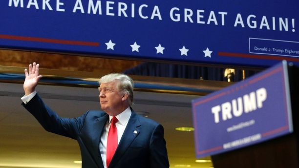 U.S. Republican presidential candidate, real estate mogul and TV personality Donald Trump acknowledges supporters prior to formally announcing his campaign for the 2016 Republican presidential nomination during an event at Trump Tower in New York June 16, 2015. REUTERS/Brendan McDermid  - TB3EB6G1A5EOV