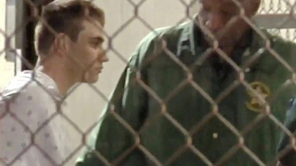 Police escort Nikolas Cruz into Broward County Jail following a shooting incident at Marjory Stoneman Douglas High School, in Fort Lauderdale, Florida, U.S. February 15, 2018 in a still image from video.  WSVN.com via REUTERS. ATTENTION EDITORS - THIS IMAGES HAS BEEN PROVIDED BY A THIRD PARTY. NO RESALES, NO ARCHIVES. MANDATORY CREDIT. NO ACCESS SOUTHEAST FLORIDA MEDIA. - RC1625BF04C0