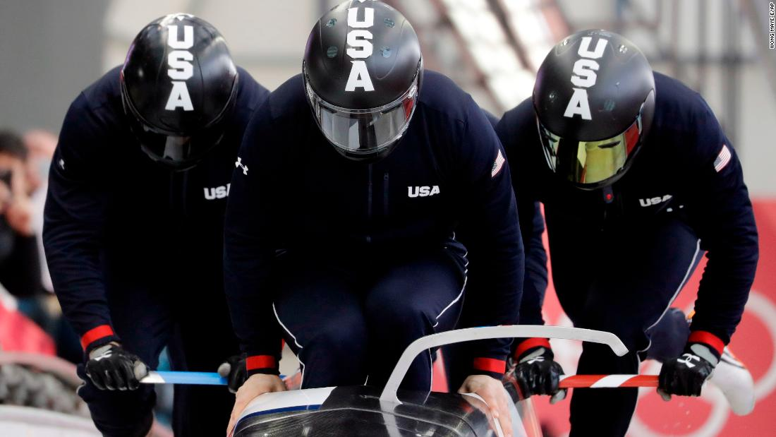 A US team starts a training run for the four-man bobsled.