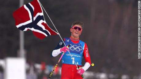 Johannes Hoesflot Klaebo  celebrates after Norway win men's 4x10km relay in Pyeongchang.